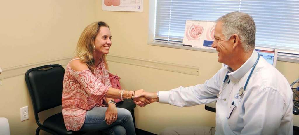Dr. Jeff Storey of Cheyenne Women's Clinic talks with a patient
